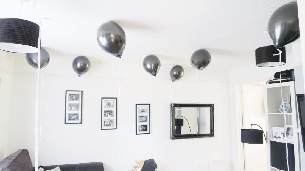 black birthday balloons