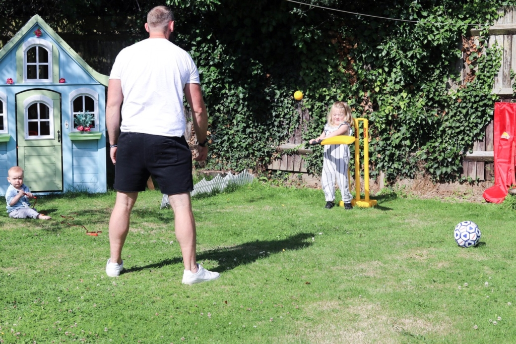 toddler playing cricket